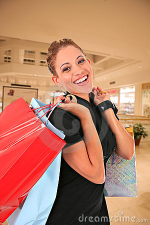 Happy smiling female shopper holding shopping bags