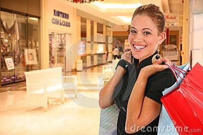 Happy smiling female shopper at shopping center