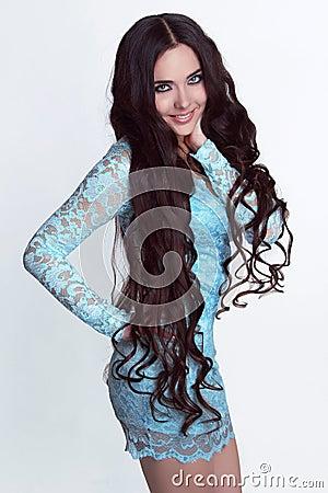 Happy smiling girl model. Healthy Long Curly Hair