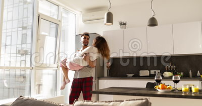 Happy Smiling Hispanic Man Carry Asian Woman, Young Romantic Couple Turning Aroud Together In Kitchen. Slow Motion stock footage