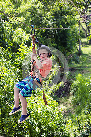 Free Happy Smiling Little Boy Riding A Zip Line In A Lush Tropical Forest Stock Image - 71184221