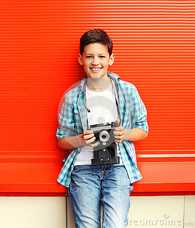 Free Happy Smiling Little Boy Teenager With Retro Vintage Camera Stock Photo - 61636040