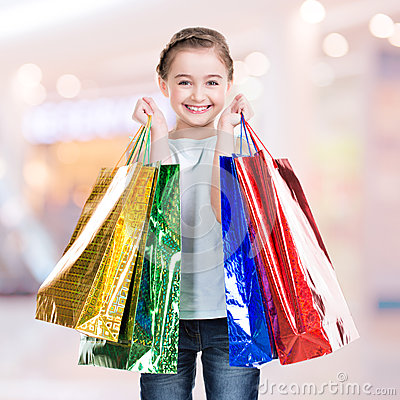 Happy  smiling little girl with shopping bags