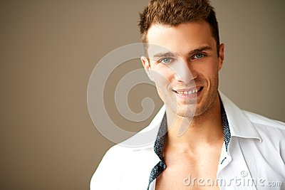 Happy smiling man posing in white shirt