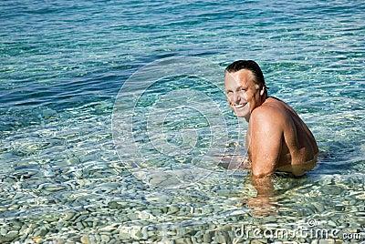 Happy smiling man in sea