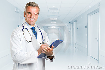Happy smiling mature doctor