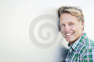Happy smiling mature man in forties.