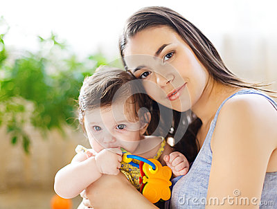 Mother with eight month old baby girl