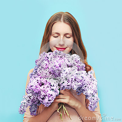 Free Happy Smiling Woman Enjoying Smell Bouquet Lilac Flowers Over Colorful Blue Background Stock Photos - 71958693