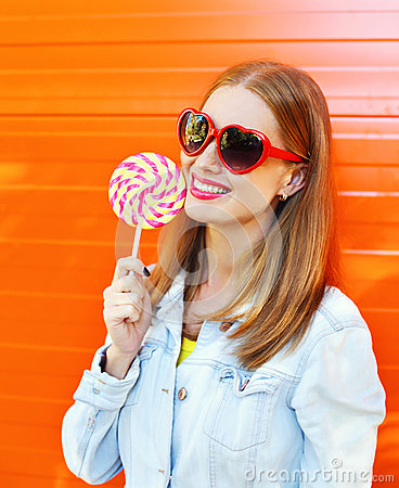 Free Happy Smiling Woman In Sunglasses With Sweet Lollipop Over Colorful Orange Background Royalty Free Stock Photography - 65564927