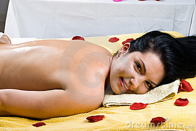 Happy smiling woman at spa salon