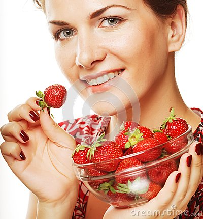 Happy smiling woman with strawberry