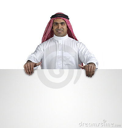 Happy smiling young arab businessman showing blank