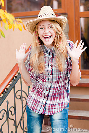 Happy smiling young girl in cowboys hat