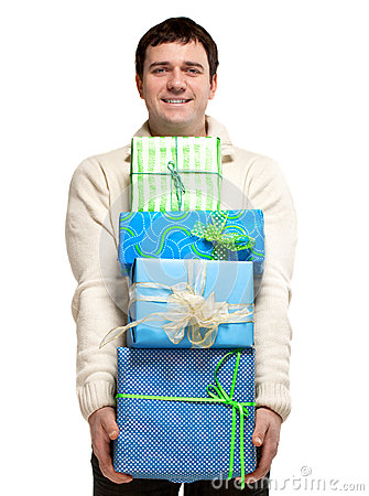 Happy smiling young man with presents