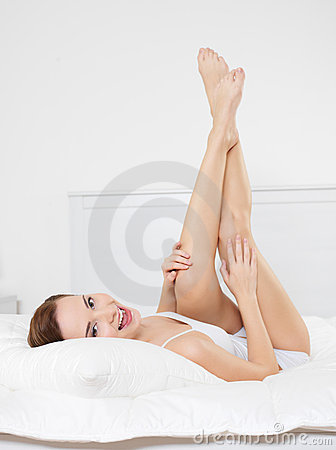 Happy smiling young woman with beautiful legs