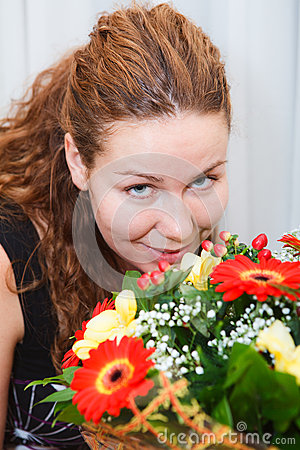 Happy smiling young woman with flowers