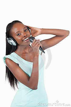 Happy smiling young woman singing