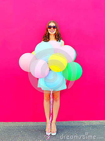 Free Happy Smiling Young Woman With An Air Colorful Balloons Having Fun In Summer Over A Pink Background Royalty Free Stock Images - 91212509