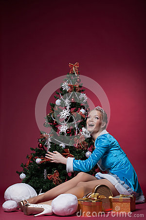 Happy Snow Maiden posing with Christmas tree