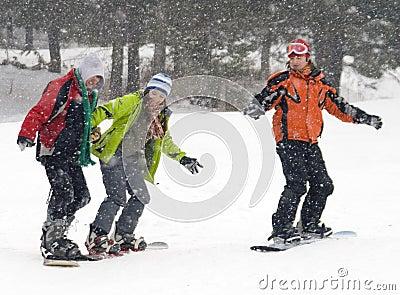 Happy snowboarding teens team