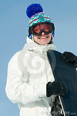 Happy sportsman with snowboards