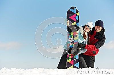 Happy sportswoman with snowboard