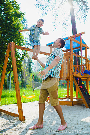 Free Happy Sporty Little Boy Standing On My Father S Arm Royalty Free Stock Photography - 76782507