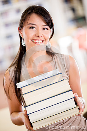 Happy student carrying books