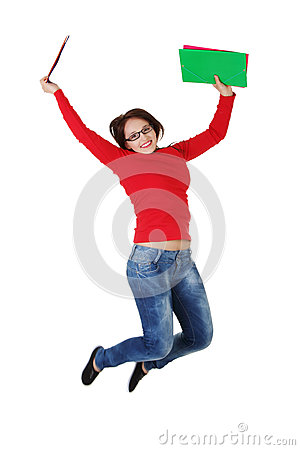 Happy student girl jumping.