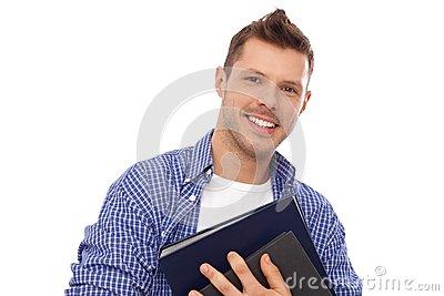 Happy student holding books