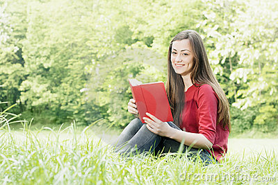 Happy student outdoors relaxed