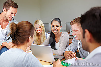 Happy student with peers in college