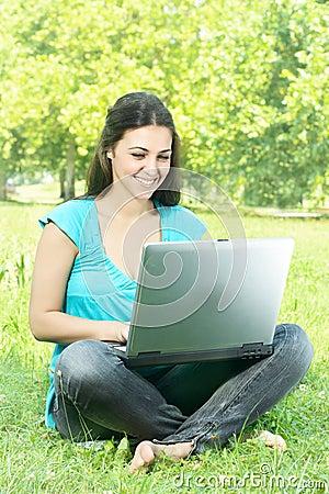 Happy student using laptop