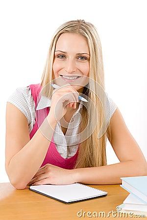 Happy student woman write homework