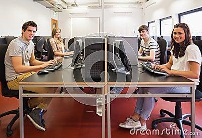 Happy students in computer room