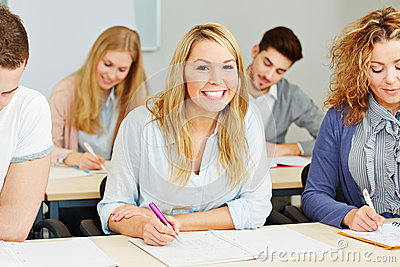 Happy students taking notes