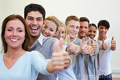 Happy students with their thumbs up