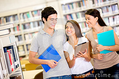 Happy students using a tablet computer