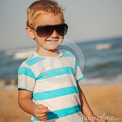 Free Happy Stylish Boy In Sunglasses And Striped T-shirt Enjoying Life On Summer Beach Royalty Free Stock Photo - 116895735