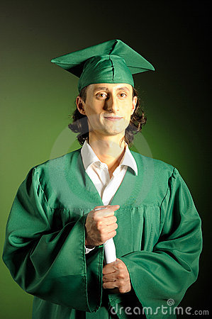 Happy succesful man on his graduation day in green