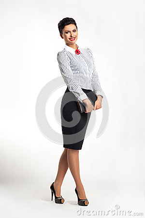 Happy successful business woman with notepad