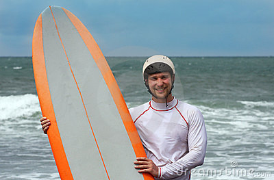 Happy surfing man on bali island