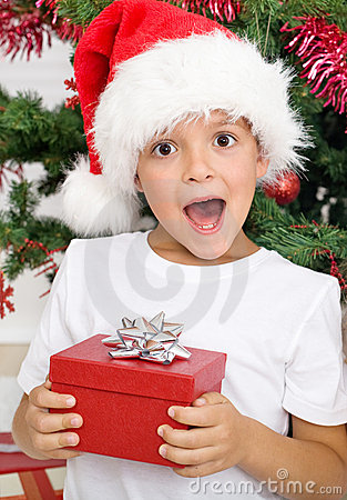 Happy surprised kid with christmas present