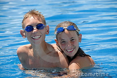 Happy swimmers in pool