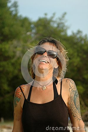 Happy tattoo woman