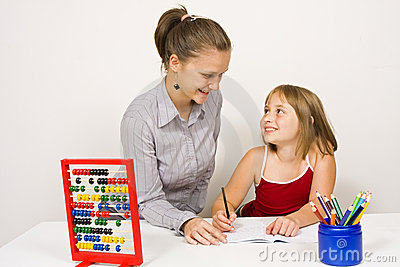 Happy teacher and little girl