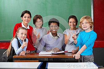 Happy Teacher And Schoolchildren