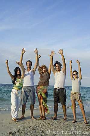 Happy team on the beach
