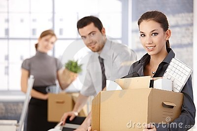 Happy team of businesspeople moving office